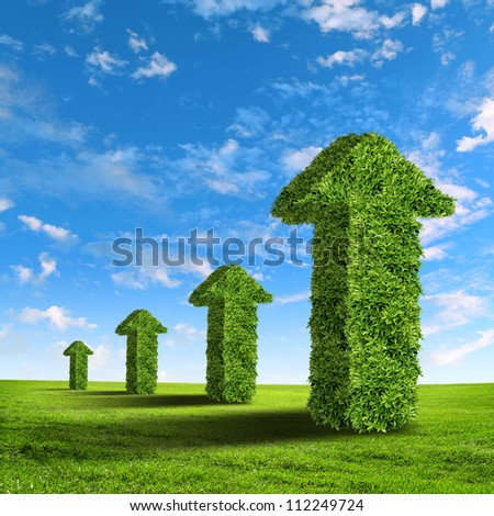 Green grass word success against blue sky - stock photo