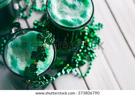 Green: Green Beer With Shamrock Necklace For St. Patrick's Day - stock photo