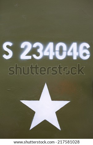 Green grunge design of a military army star background with fake number printed in white - stock photo