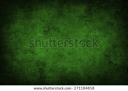 Green grunge textured wall. Dark edges. Advertising copy space - stock photo