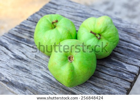green guava on wood desk - stock photo