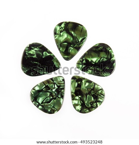 Green guitar plectrums isolated on a white background