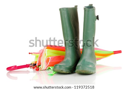 green gumboots and umbrella isolated on white - stock photo