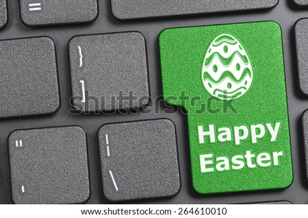 Green happy easter key on keyboard - stock photo