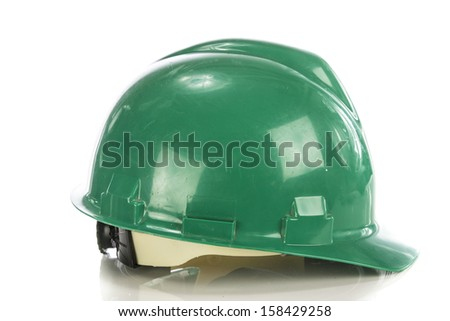 Green hardhat isolated om white - stock photo