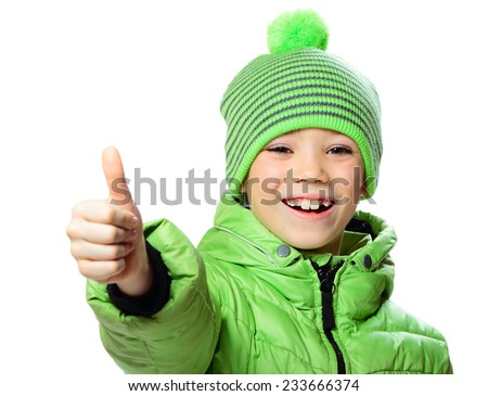 Green hat and jacket clothing boy showing thumb up on white background - stock photo