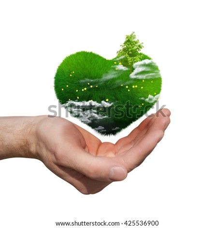 green heart in the palm. environmental concept