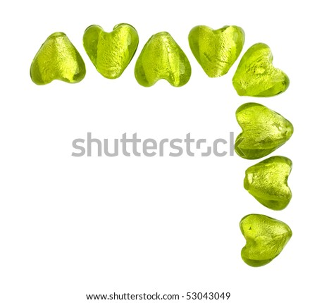 Green heart shaped glass beads in a corner - stock photo