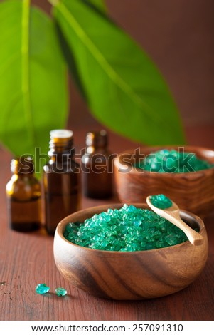 green herbal salt and essential oils for healthy spa bath - stock photo