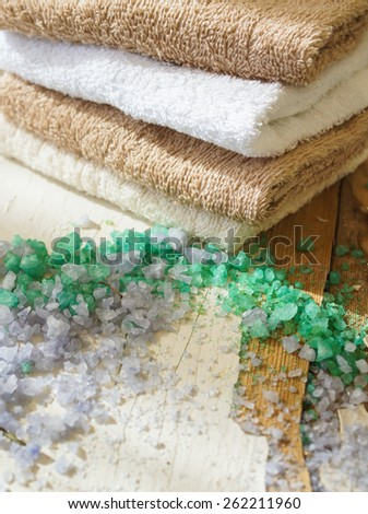 Green herbal spa with few kinds of sea salt, rosemary and snowdrop flowers - stock photo
