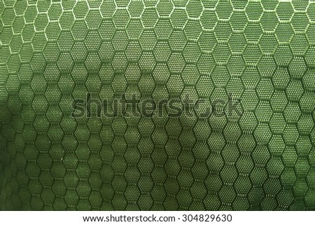 green hexagonal synthetic pattern fabric background - stock photo