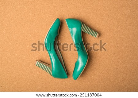 green high heels shoes on brown background - stock photo