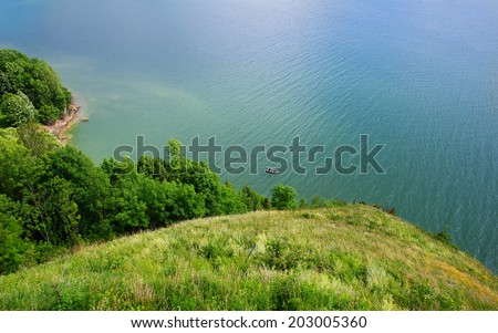 green hill above the ocean, cornwall - stock photo