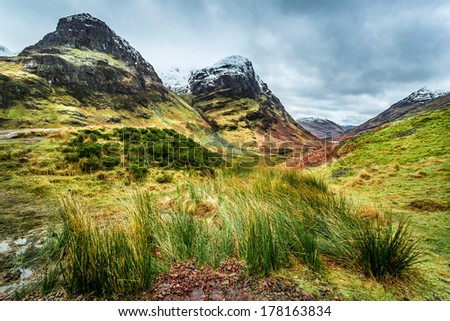 Green hills and snowy peaks in Scotland
