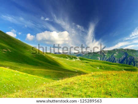 Green hills in mountain valley. Summer landscape