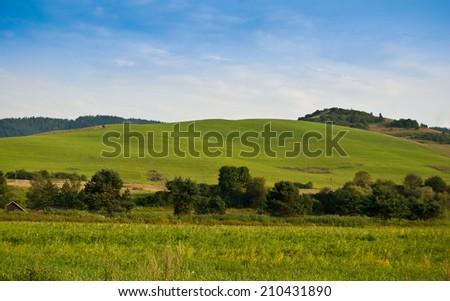 Green hills near Cerveny Klastor in Pieniny mountains, Slovakia - stock photo