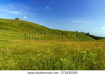 Green hills on a sunny summer day - stock photo