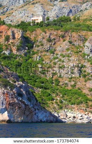 Green hills on the coastal line of Adriatic sea - stock photo