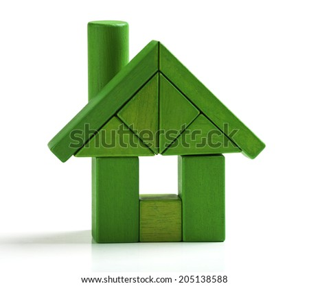 Green house, energy efficiency home save heat and ecology. Toy blocks isolated white background - stock photo