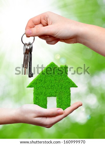 green house in hand  - stock photo