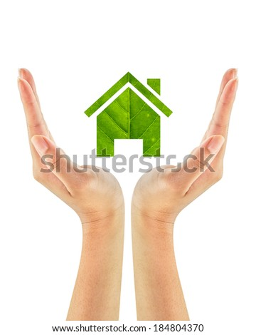 Green house made of green leaf on woman hands isolated on a white background. Ecology Concept. Environmentally friendly. - stock photo