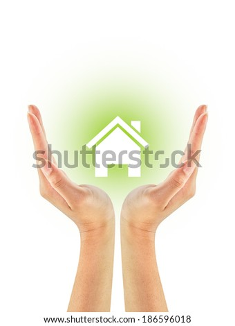 Green house shape on woman hands isolated on a white background. Ecology Concept. Environmentally friendly. - stock photo