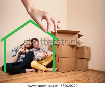 Green house shape with young family inside