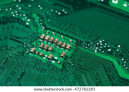 green integrated circuit motherboard pcb printed board with chip microchip abstract background pattern