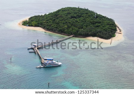 GREEN ISLAND, AUSTRALIA - MARCH 28:Areal view of Green Island, Great Barrier Reef, Australia on March 28, 2011. Green Island s located within the Great Barrier Reef Marine Park World Heritage Area - stock photo