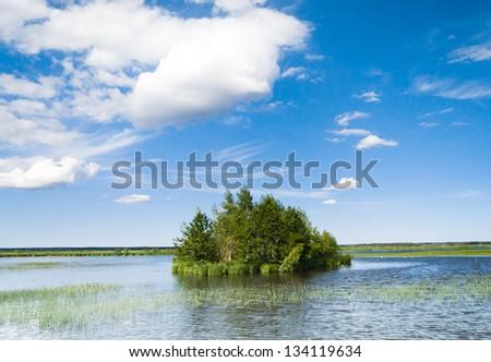 Green Island Cloudscape Above - stock photo