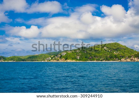 Green island with blue sky and sea, View of Kohtao island, Thailand - stock photo