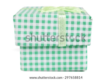 Green jewelry ring cardboard box with pattern and ribbon isolated on white background