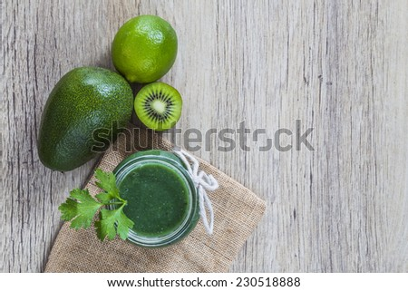 Green juice and ingredients - stock photo
