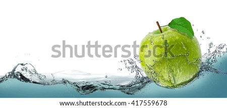Green, juicy apple as a card on the water background. - stock photo