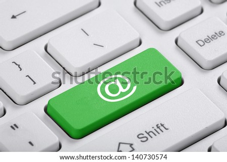 Green key of the computer. The concept