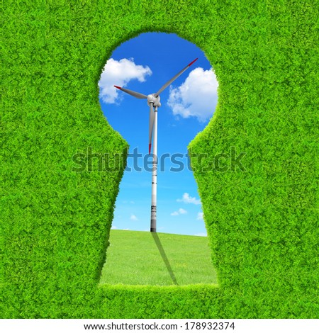 Green keyhole. On the background wind turbine. Green energy concept. - stock photo