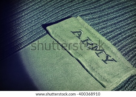 Green Khaki Military Uniform Male Sweater With Embroidered Sign Army On The Chest Pocket, Top View, Close Up