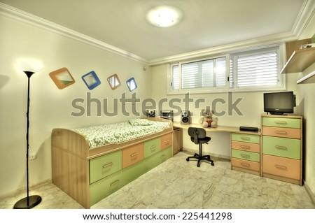 Green kid`s bedroom - stock photo