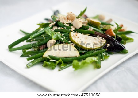 Green kidney salad with pear slices - stock photo