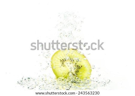 Green kiwi with water bubbles isolated on a white background - stock photo