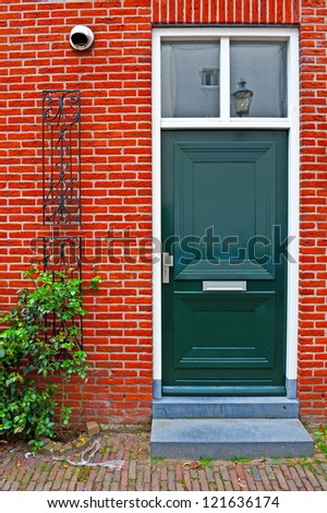 Green Lacquered Door in the Dutch City - stock photo