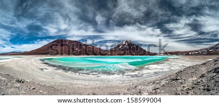 Green Lagoon (Laguna Verde) is a highly concentrated salt lake located in the Eduardo Avaroa Andean Fauna National Park at the foot of the Licancabur volcano, Sur Lipez Province, Bolivia. - stock photo