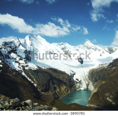 Green lake and white mountain in Cordilleras mountain - stock photo