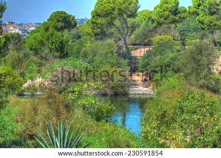 green lake in Cagliari, Italy. Heavy processed for hdr tone mapping effect - stock photo