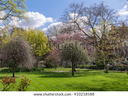 Green Lawn of a Spacious London City Park - stock photo