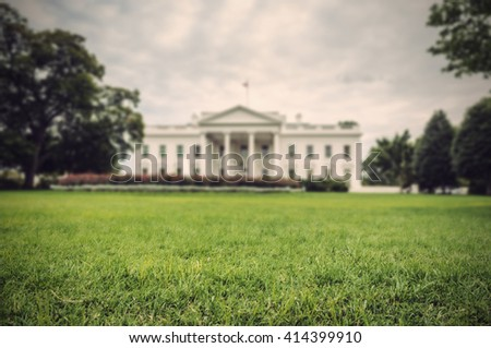 green lawn with the blurred White House in background, Washington D.C., USA, Vintage filtered style
