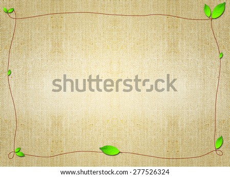 green leaf border flora frame over brown grungy parchment canvas background. Backdrop, invitation card design idea template wallpaper. Decoration, ornament, layout, artistic design. - stock photo