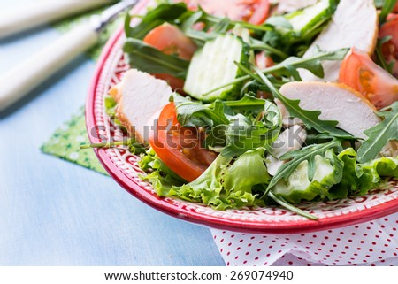 Green leaf salad with vegetables and chicken, closeup, selective focus - stock photo