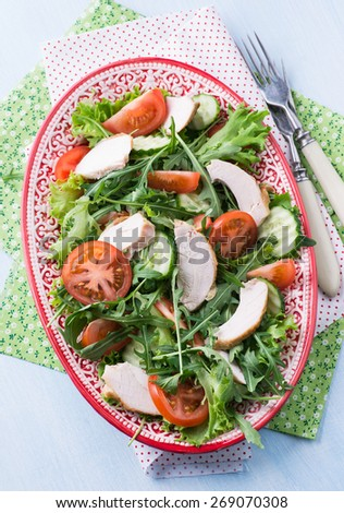 Green leaf salad with vegetables and chicken, top view - stock photo