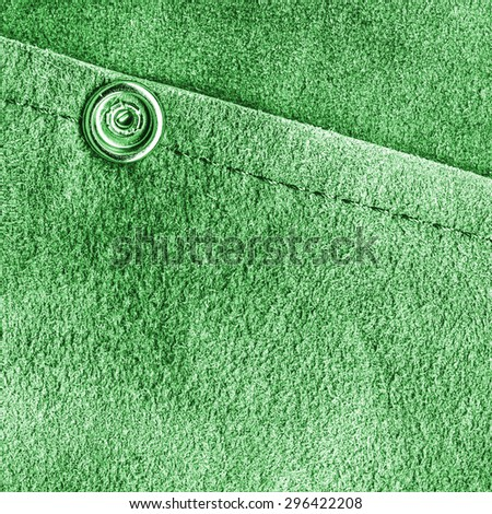 green leather background decorated with seam and button